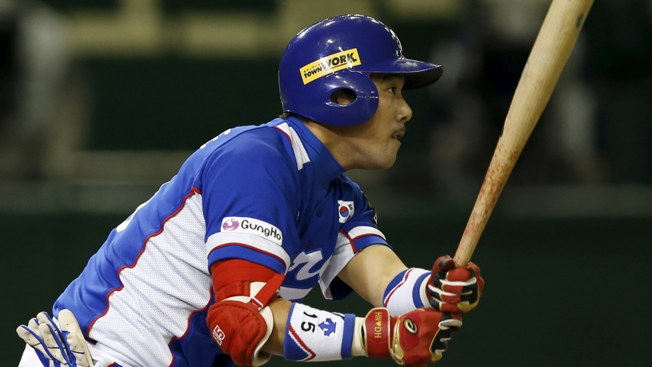 South Korea's Lee Yong-kyu watches the ball after hitting an RBI double at the Premier12 international baseball tournament at Tokyo Dome in 2015.