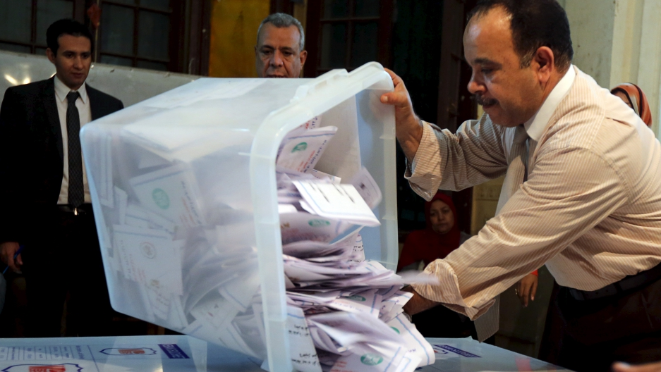 Officials count ballots after polls closed during the second round of parliamentary election in Cairo, Egypt, on Nov. 23, 2015.