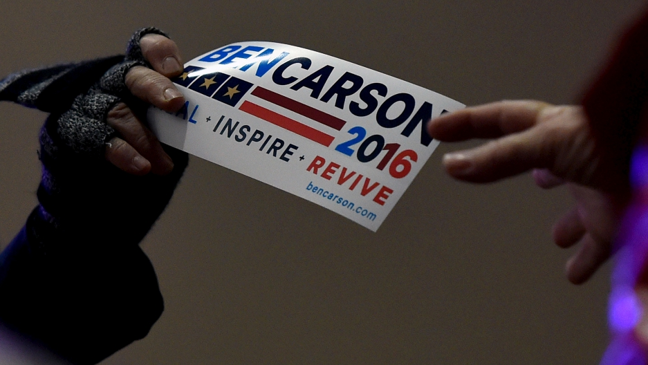 A bumper sticker is passed out before U.S. Republican presidential candidate Ben Carson speaks at a campaign event in Pahrump, Nevada.