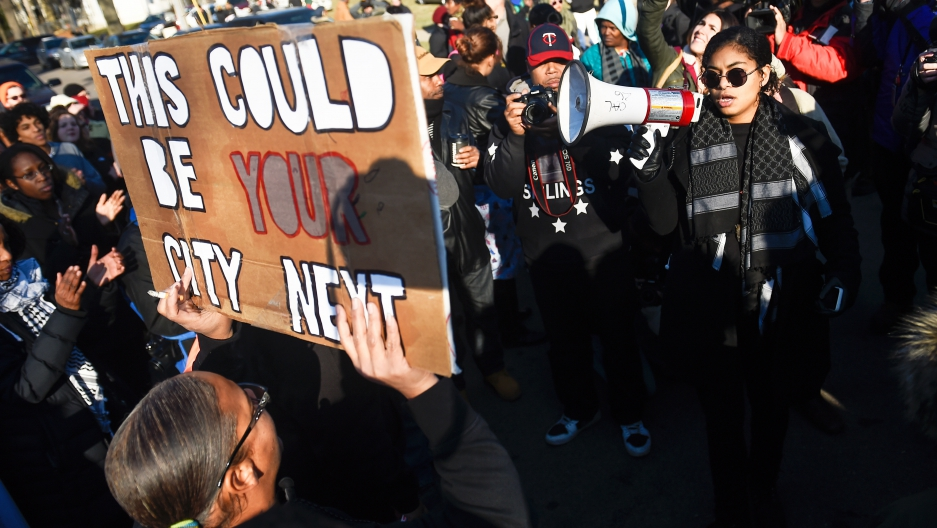 A gathering crowd of the group Black Lives Matter before they march to city hall during a protest in Minneapolis, Minnesota November 24, 2015.