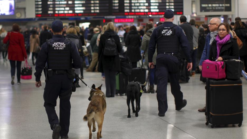 Amtrak Police K-9 teams patrol a busy Pennsylvania Station in the Manhattan borough of New York City, November 25, 2015.
