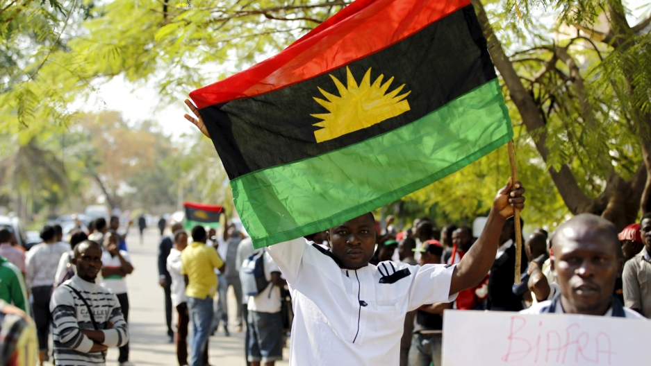 A supporter of Indigenous People of Biafra leader Nnamdi Kanu holds a Biafra flag during a rally in support of Kanu, who was arrested on charges of criminal conspiracy and belonging to an illegal societyAbuja, Nigeria December 1, 2015.