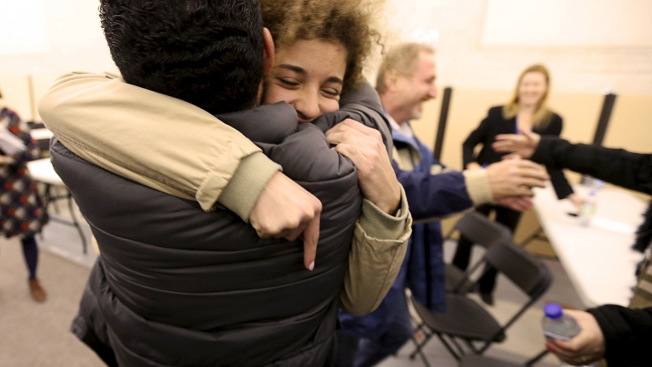 Anas Francis is reunited with his cousin Syrian refugee Laila Beylouneh, 13, at the Welcome Centre in Montreal, Quebec, December 12, 2015.
