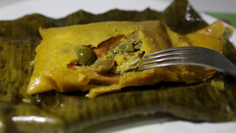 A Hallaca is a typical Venezuelan dish made out of cornmeal and stuffed with beef, pork, chicken, raisins, capers and olives and then wrapped in a banana leaf and traditionally served on Christmas and New Year's Eve.