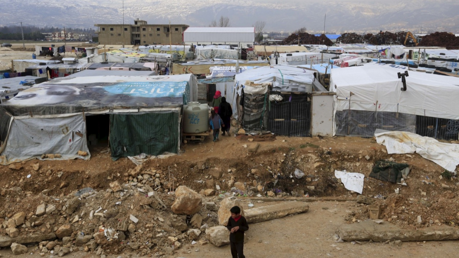 A boy stands near tents inside an informal settlement for Syrian refugees in Taanayel, Bekaa valley, Lebanon in January.
