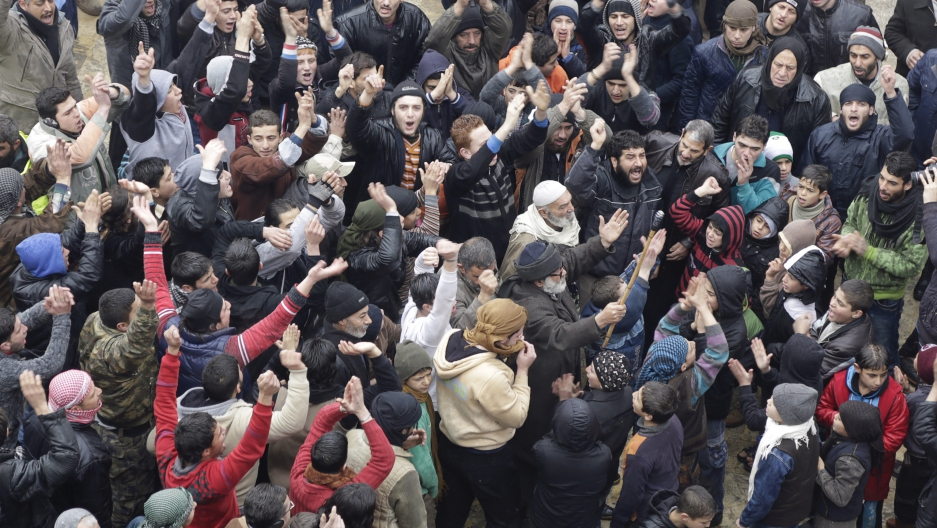People shout slogans during a protest after Friday prayers, calling for the lifting of the siege off Madaya, in the rebel-controlled area of Maaret al-Numan town in Idlib province, Syria January 8, 2016.