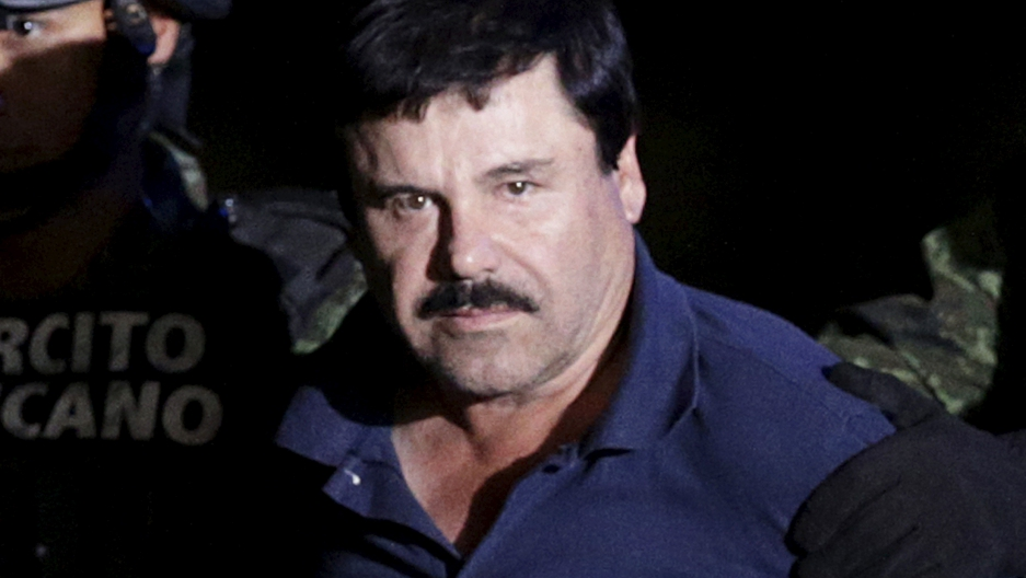 """Recaptured drug lord Joaquin """"El Chapo"""" Guzman is escorted by soldiers at the hangar belonging to the office of the Attorney General in Mexico City"""