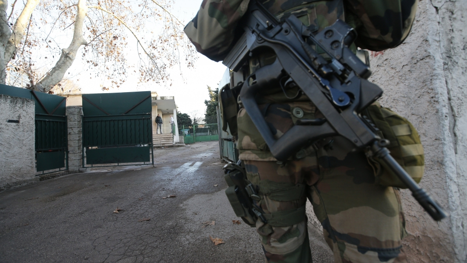 A French soldier secures access to a Jewish school in Marseille, France, January 11, 2016 after a teenager, armed with a machete, slightly wounded a Jewish teacher before being arrested. Armed guards are the new normal for Jewish institutions in France.