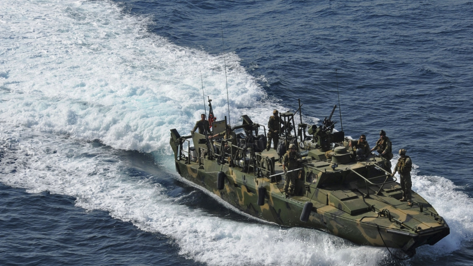 A riverine command boat from Riverine Detachment 23 operates during a maritime air support operations center exercise in the Persian Gulf in this June 12, 2012 handout photo, provided by the U.S. Navy, January 12, 2016.