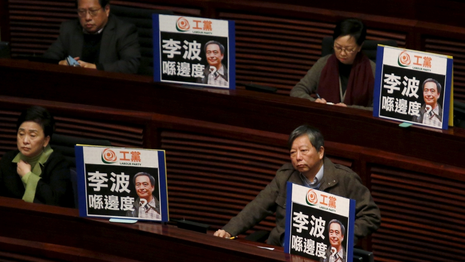 Hong Kong lawmakers protesting the disappearance of Lee Bo, one of the booksellers