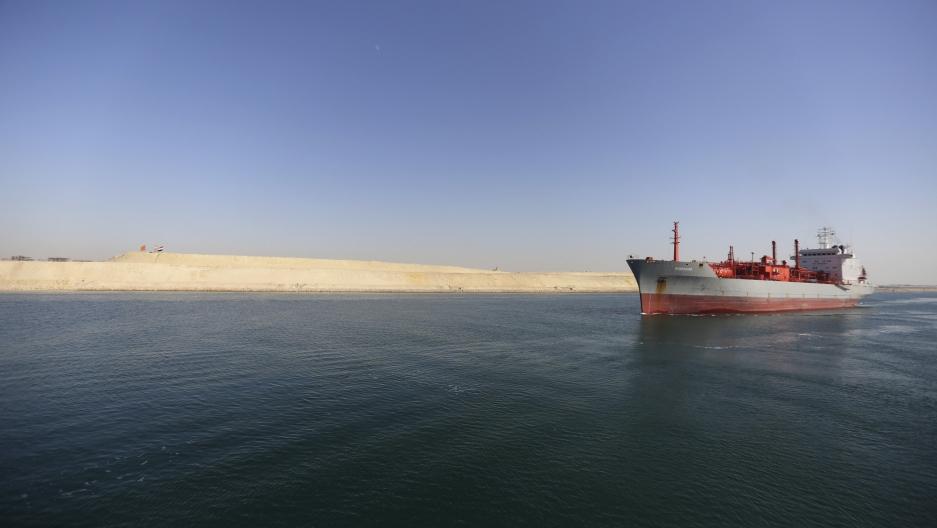 A cargo ship passing through the New Suez Canal