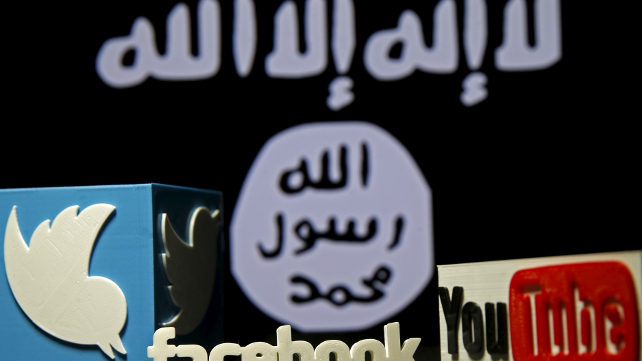 The ISIS flag next to symbols of Twitter and Facebook