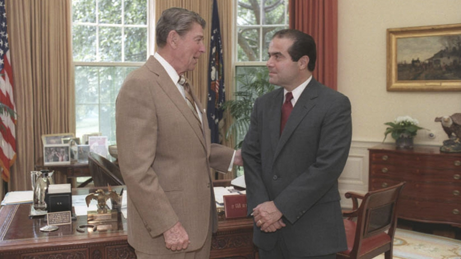 President Ronald Reagan speaks with Supreme Court Justice nominee, Antonin Scalia, in the White House Oval Office in Washington DC in 1986
