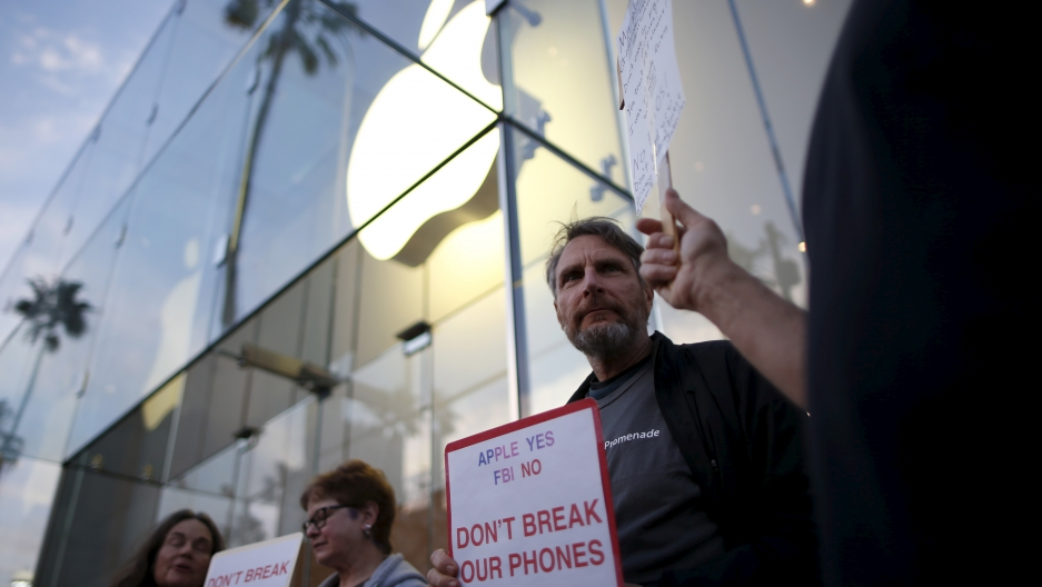 Protestors gathered at a small rally in support of Apple's refusal to help the FBI access the cell phone of a gunman involved in the killings of 14 people in San Bernardino, California in February.