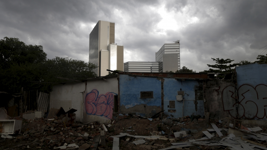Partially demolished houses in the Vila Autodromo slum with the Rio 2016 Olympic Park in the background in Rio de Janeiro, Brazil.