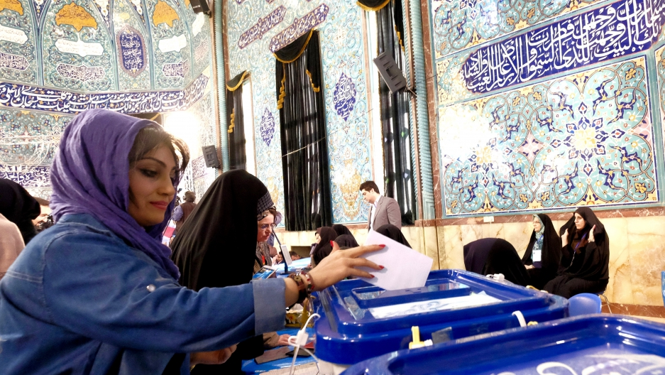 An Iranian woman casts her ballot on election day in Tehran on February 26, 2016.