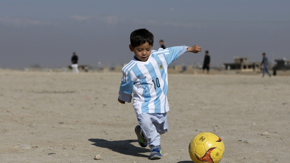 33584fac2 Afghan boy finally got the Lionel Messi jersey he always wanted