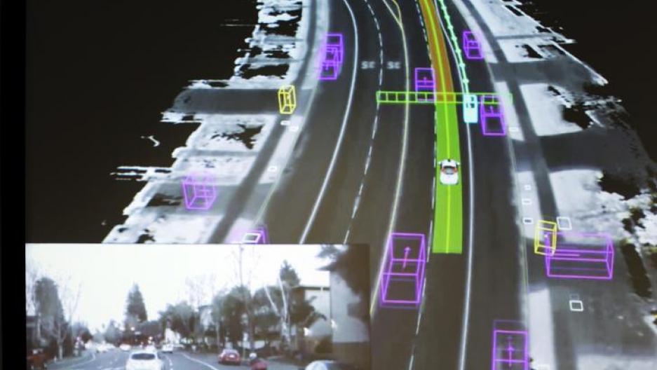 Photograph shows video captured by a Google self-driving car coupled with the same street scene as the data is visualized by the car during a presentation at a media preview of Google's prototype autonomous vehicles in Mountain View, California.