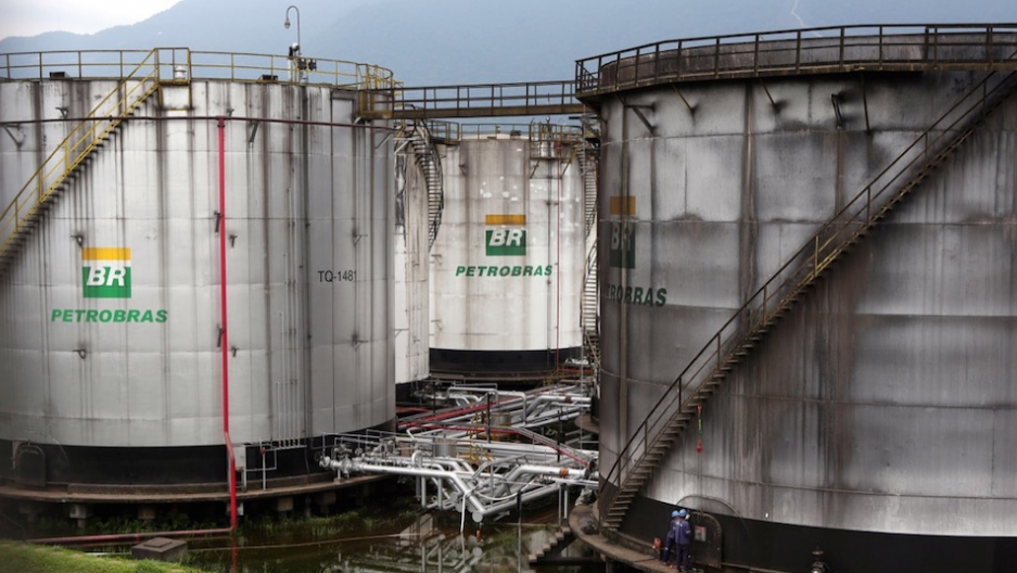 Workers repair a tank of Petrobras oil company in Cubatao, Brazil, on April 12.
