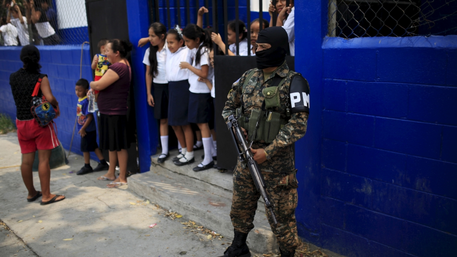 Salvadoran military police stand guard outside a school in Soyapango's La Campanera neighborhood on the outskirts of San Salvador.