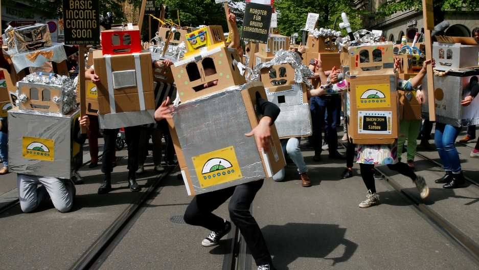 Protesters dressed as robots demand a basic income