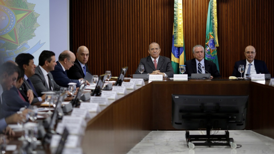 Brazil's Chief of Staff Eliseu Padilha, interim President Michel Temer, Finance Minister Henrique Meirelles are seen during the first ministerial meeting at the Planalto Palace in Brasilia, Brazil, May 13, 2016.