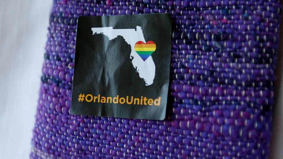 A #OrlandoUnited sticker is pictured on a clergyman's shawl before a prayer service at a memorial chapel in Orlando, Florida.