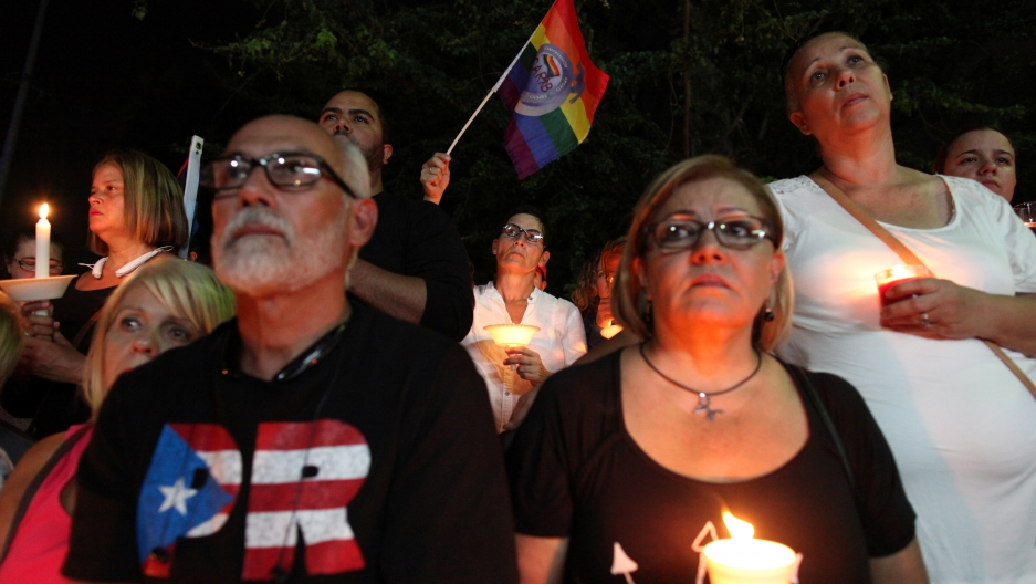 Puerto Ricans gather for a vigil in memory of the victims of the Pulse gay nightclub shooting in Orlando, in San Juan, Puerto Rico, June 14, 2016.