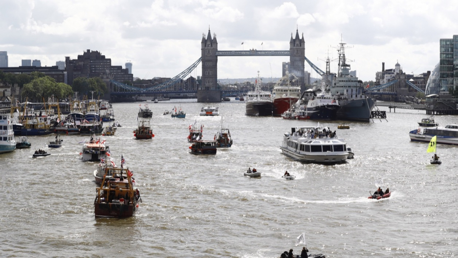 A flotilla of fishing vessels campaigning to leave the European Union sails up the river Thames in London on June 15.