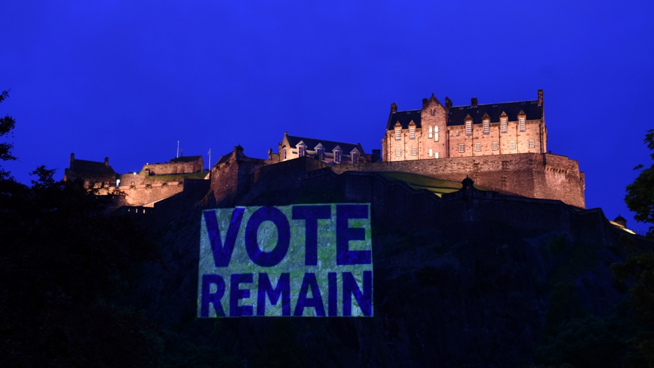 "On Tuesday, Edinburgh Castle rock was illuminated with a sign to ""Vote Remain"" in a show of support for the campaign to remain in Europe ahead of today's EU Referendum. June 21, 2016."