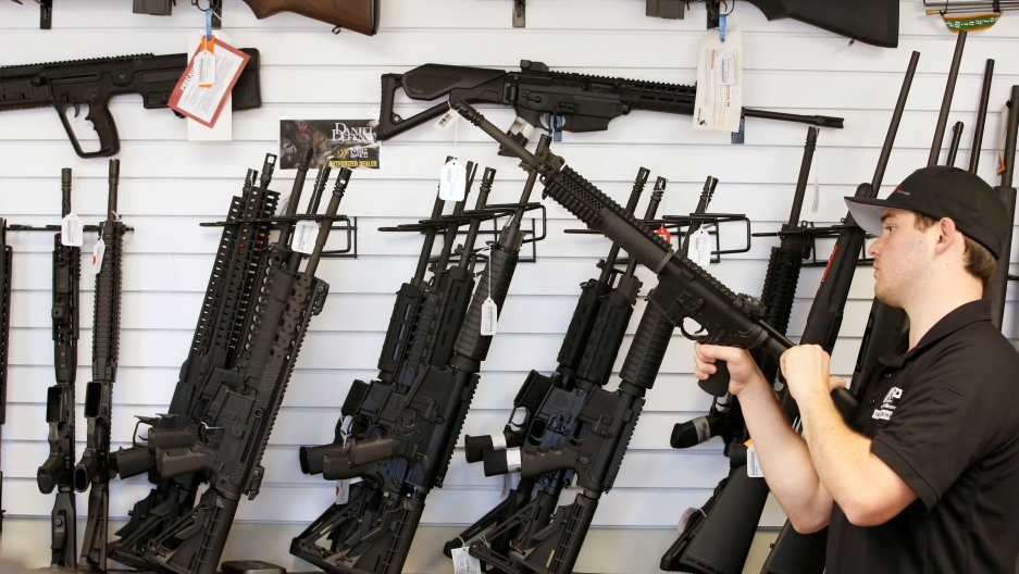 "Salesman Ryan Martinez clears the chamber of an AR-15 at the ""Ready Gunner"" gun store In Provo, Utah, U.S. in Provo, Utah, U.S., June 21, 2016."