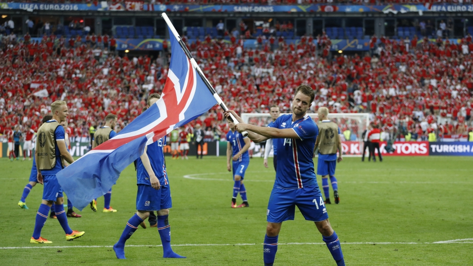 Iceland's Kari Arnason celebrates after the victorious match.