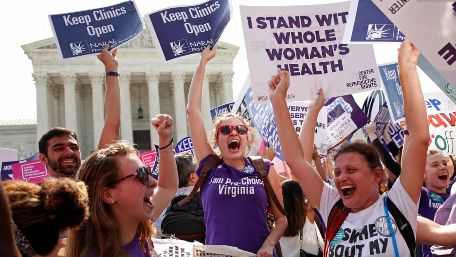 Demonstrators celebrate outside the Supreme Court Monday after it struck down a Texas law imposing strict regulations on abortion doctors and facilities that its critics contended were specifically designed to shut down clinics.