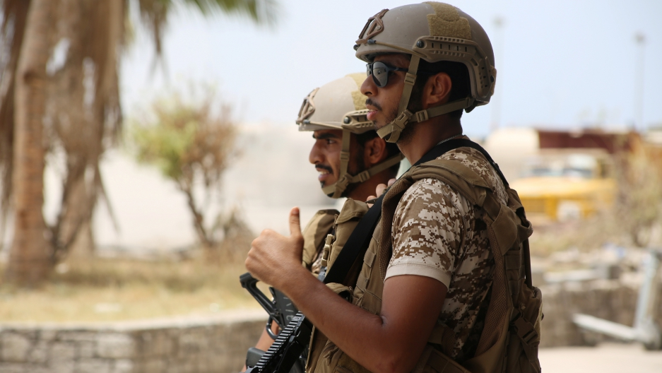 UAE soldiers stand guard at the international airport of the southern port city of Aden, Yemen.