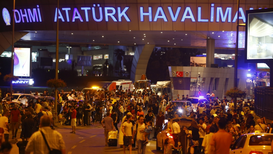People leave Turkey's largest airport, Istanbul Ataturk, Turkey, following a blast June 28, 2016.