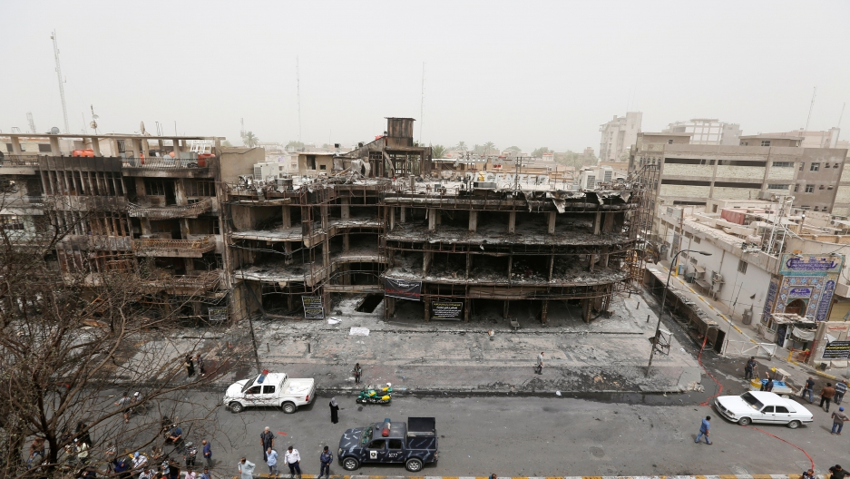 The scene a day after a horrific suicide car bomb attack on the shopping area of Karrada, Baghdad.