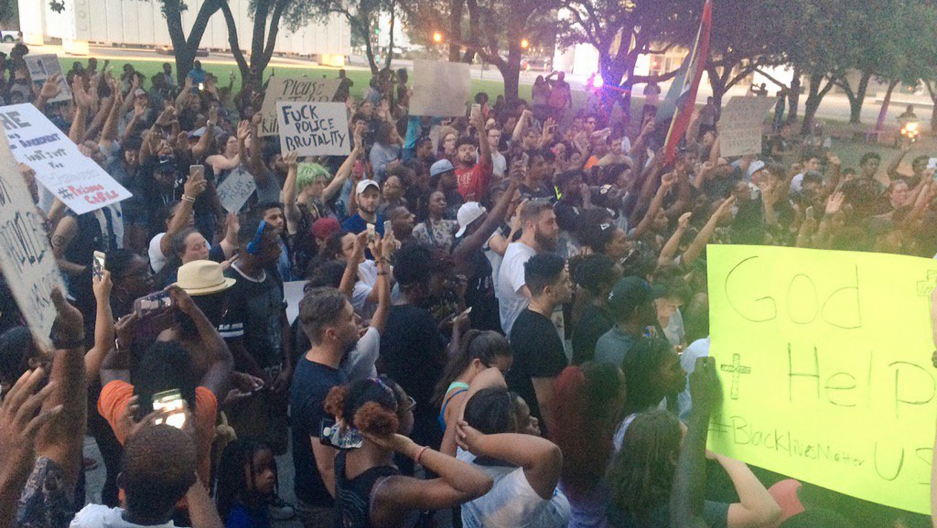 Marchers protested peacefully against police shootings of black men in Dallas, Texas, before a sniper opened fire on police and protesters.