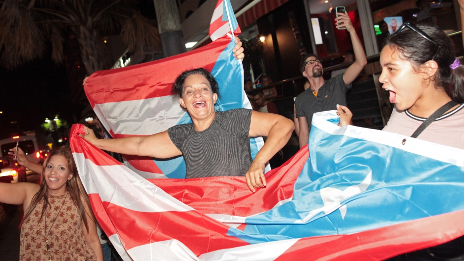 Puerto Ricans celebrate the gold medal won by Monica Puig (PUR) after she beat Angelique Kerber (GER) of Germany in the Rio Olympics.