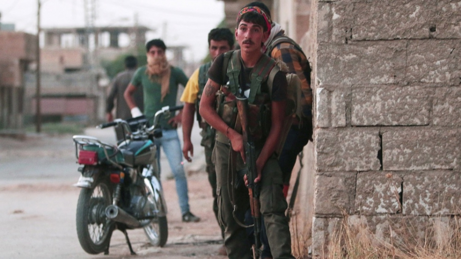 Kurdish YPG fighters take positions in the northeastern Syrian city of Hasaka, on Aug. 20.