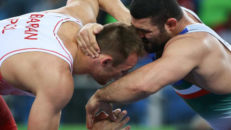 Wrestlers Radoslaw Baran (POL) of Poland and Reza Yazdani (IRI) of Iran compete in the ​2016 Rio Olympics, Rio de Janeiro, Brazil.