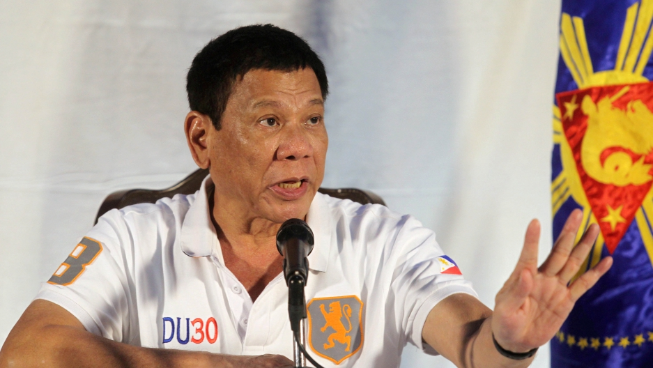 Philippine President Rodrigo Duterte speaks during a news conference in Davao city.