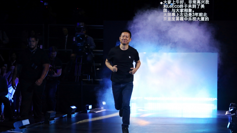 LeEco CEO and founder Jia Yueting runs on stage during a press event in San Francisco, California on Oct. 19.