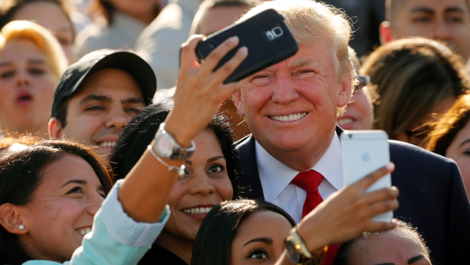Trump poses for selfies in Miami, Florida, on October 25, 2016.