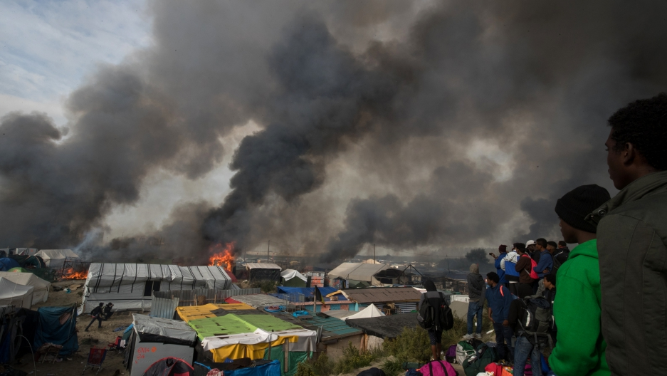 Fires broke out in many parts of the camp as the authorities attempted to clear it of residents.
