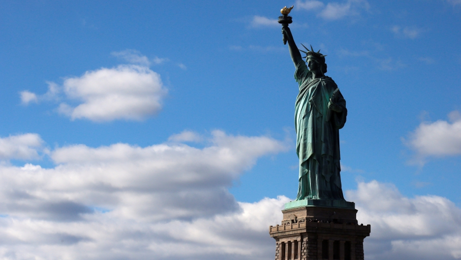 The Statue of Liberty is seen on the 130th anniversary of the dedication in New York Harbor, in New York City.