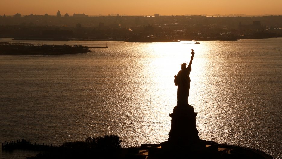 The sun rises on the Statue of Liberty, in New York, November 2nd 2016