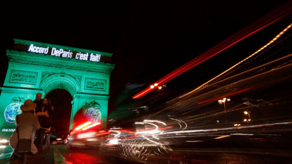 "The Arc de Triomphe is illuminated in green with the words ""Paris Agreement is Done"" to celebrate the United Nations climate change agreement in Paris, France, on Nov. 4."