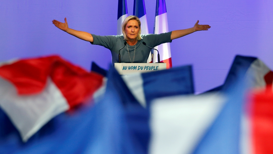 Marine Le Pen, French National Front leader, gestures during a rally