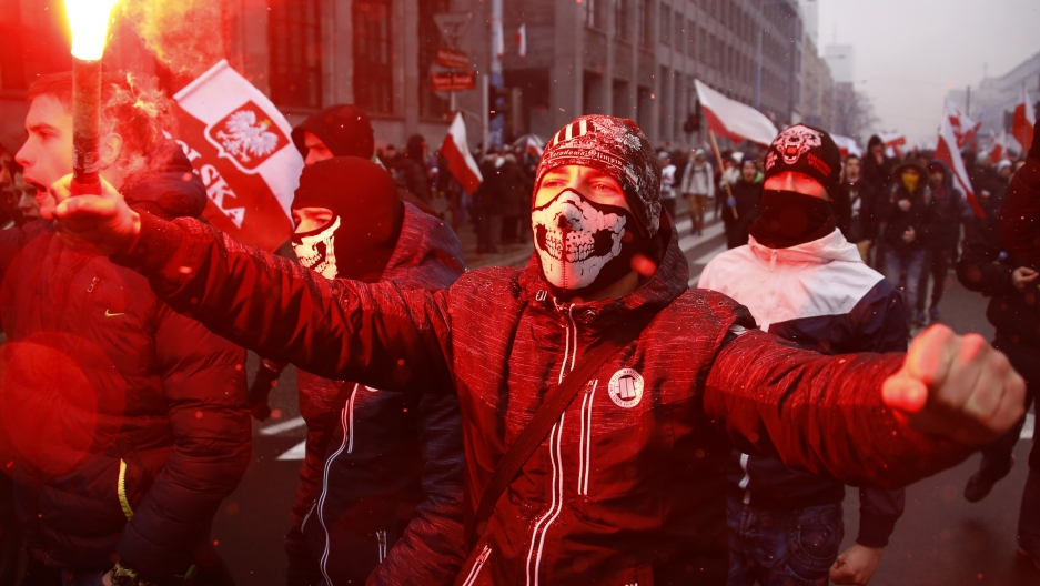 Protesters light flares and carry Polish flags during a rally, organised by far-right, nationalist groups, to mark the anniversary of Polish independence in Warsaw.