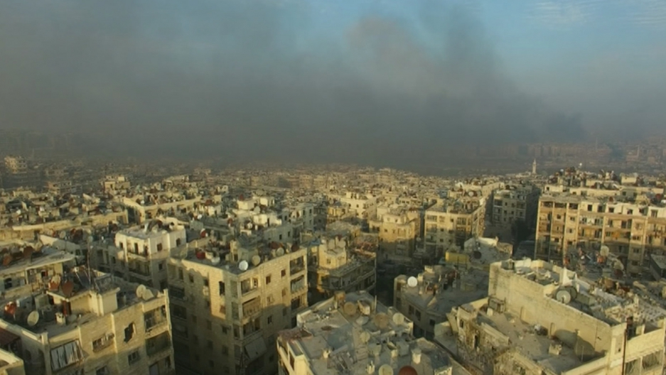 Smoke rising over bomb-damaged eastern Aleppo, Syria, on Dec. 12, 2016.